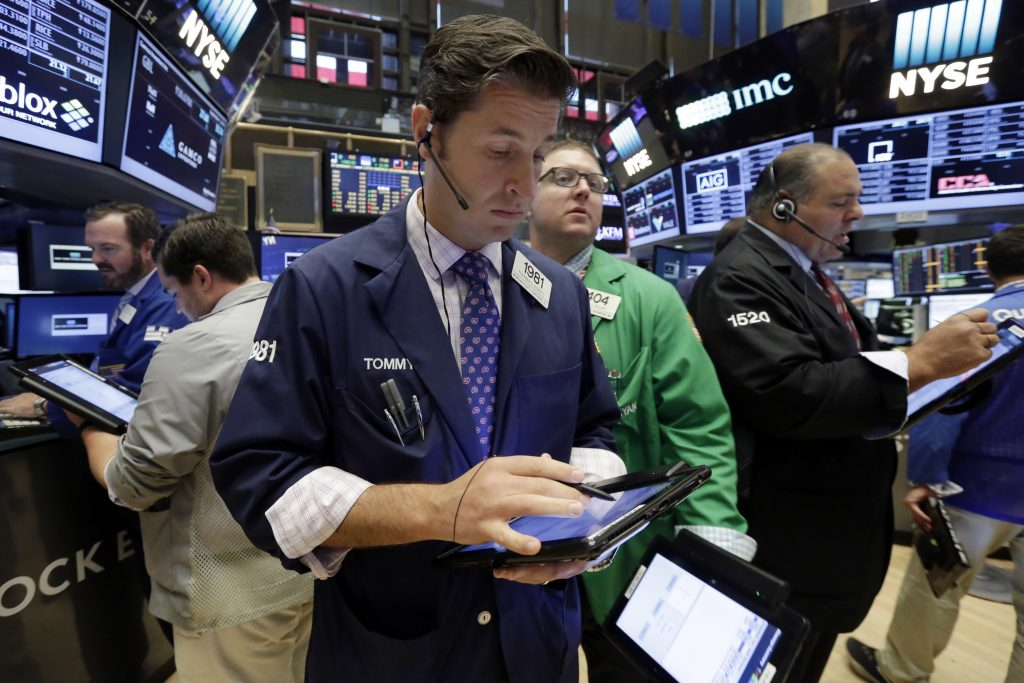 Trader Thomas Donato, center, works on the floor of the New York Stock Exchange on Thursday. (AP Photo/Richard Drew)