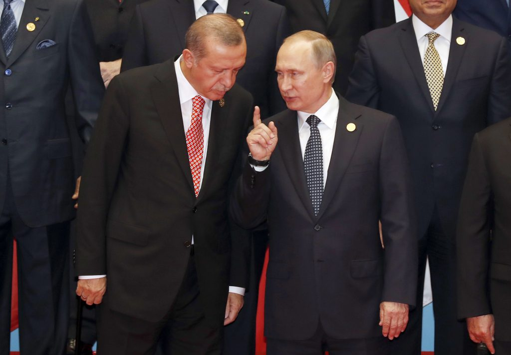 In this Sunday, Sept. 4, 2016 photo, Russian President Vladimir Putin, right, and Turkish President Recep Tayyip Erdogan chat during a group photo session for the G-20 Summit at the Hangzhou International Expo Center in Hangzhou in eastern China's Zhejiang province. (AP Photo/Ng Han Guan)