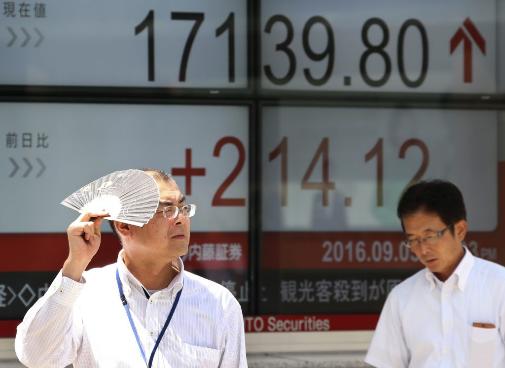 Anelectronic stock board of a securities firm in Tokyo on Monday. (AP Photo/Koji Sasahara)