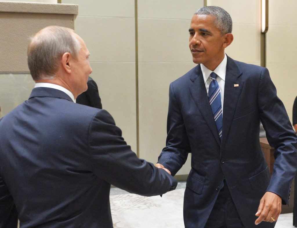 Russian President Vladimir Putin (L) shakes hands with U.S. President Barack Obama in Hangzhou in eastern China's Zhejiang province, Monday on the sidelines of the G-20 summit. (Alexei Druzhinin, Sputnik, Kremlin Pool Photo via AP)