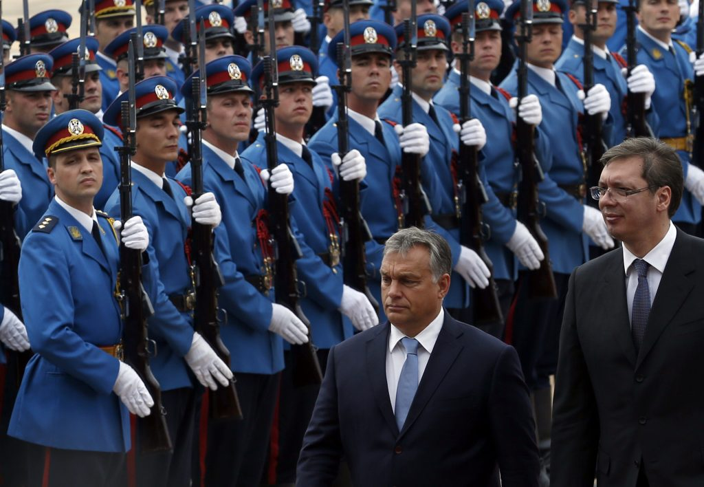 Hungary's Prime Minister Viktor Orban, center, reviews the honor guard upon his arrival at the Serbia Palace to meet Serbian Prime Minister Aleksandar Vucic, right, in Belgrade, Serbia, on Monday. (AP Photo/Darko Vojinovic)