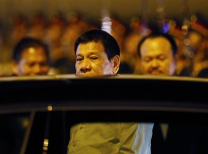 Philippine President Rodrigo Duterte boards his limousine upon arrival in Vientiane, Laos, on Monday. (AP Photo/Bullit Marquez)