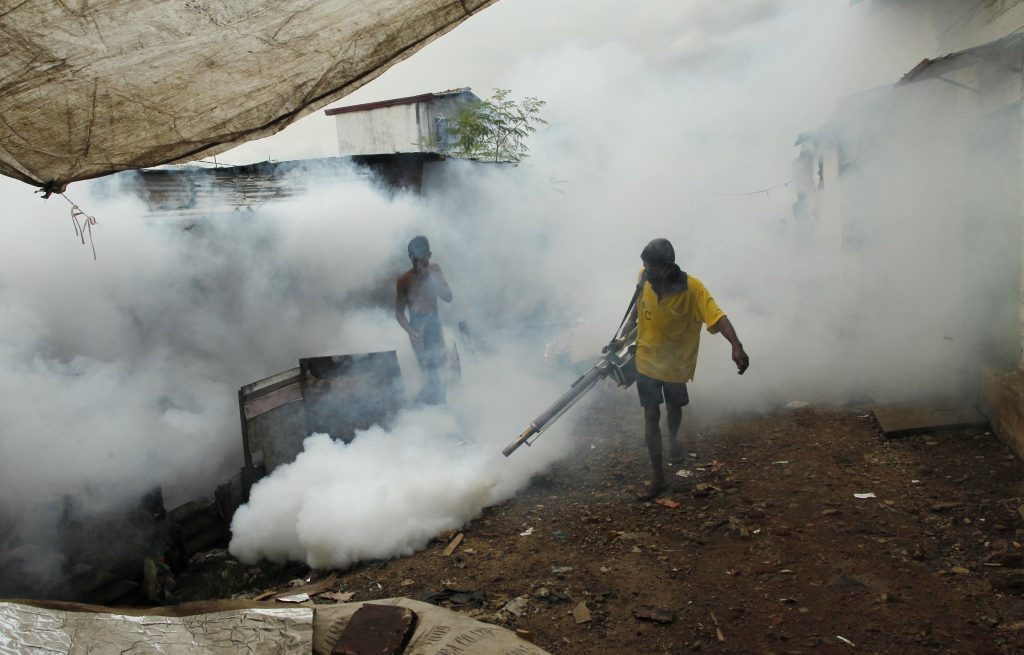 In this 2011 photo, a laborer fumigates buildings to control mosquitoes in Colombo, Sri Lanka. (AP Photo/Eranga Jayawardena, File)