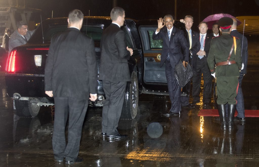 U.S. President Barack Obama getting into his motorcade vehicle as he arrives on Air Force One at Wattay International Airport in Vientiane, Laos, on Monday.. (AP Photo/Carolyn Kaster)