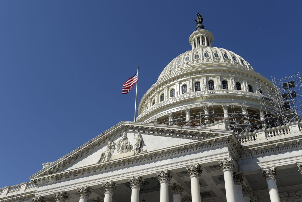 An American flag flies over Capitol Hill in Washington, Tuesday, Sept. 6, as lawmakers return from a 7-week break. (AP Photo/Susan Walsh)