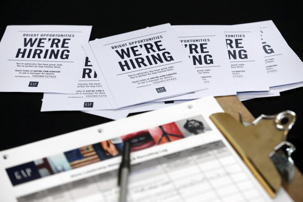 FILE - In this Tuesday, Oct. 6, 2015, file photo, job applications and information for the Gap Factory Store sit on a table during a job fair at Dolphin Mall in Miami. Fewer Americans applied for unemployment benefits last week of Aug. 2016, another sign the U.S. job market remains healthy despite a downshift in hiring in August. The Labor Department says the number of applications for jobless aid slid by 4,000 last week to a seasonally adjusted 259,000, lowest since mid-July. (AP Photo/Wilfredo Lee, File)