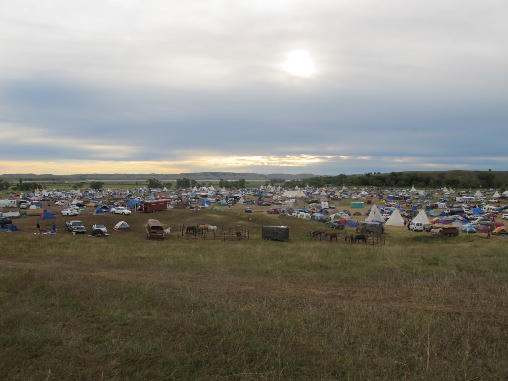 More than a thousand people gather at an encampment near North Dakota's Standing Rock Sioux reservation on Friday. (AP Photo/James MacPherson)