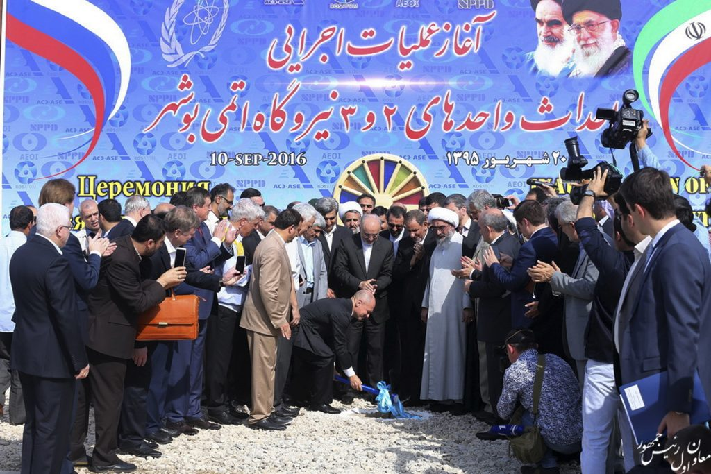 In this photo released by official website of the office of the Iranian Senior Vice-President on Saturday, Sept. 10, 2016, head of Russia's federal atomic agency Sergey Kiriyenko breaks ground in a ceremony to begin building Iran's second nuclear power plant, in the southern port city of Bushehr, Iran. Iran began building its second nuclear power plant with Russian help on Saturday, the first such project since last year's landmark nuclear deal with world powers, state TV reported. (Iranian Senior Vice-President's Office via AP)
