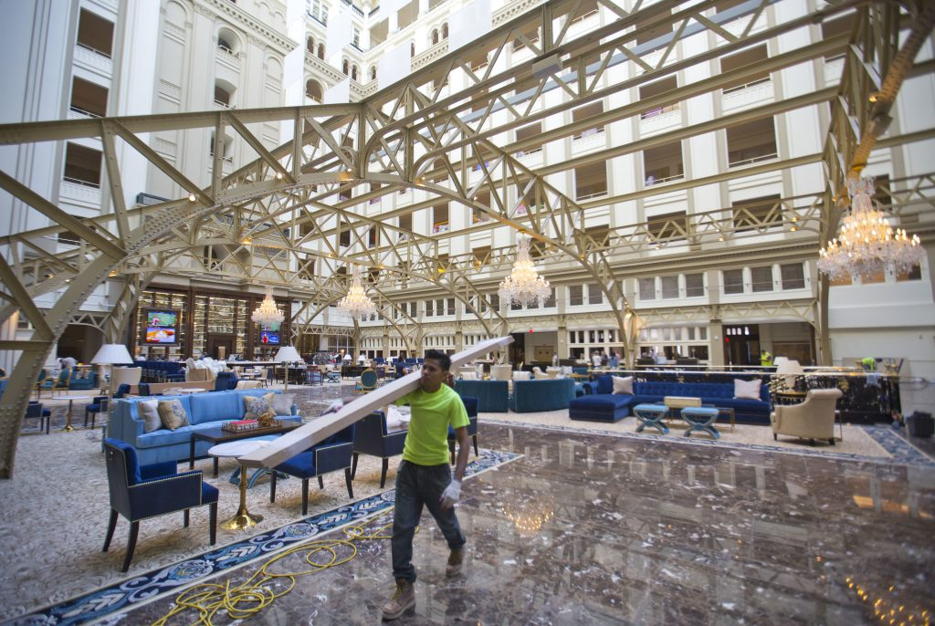 """Workers continue work at the Trump International Hotel during the """"soft-opening"""" in downtown Washington, Monday in Washington. (AP Photo/Pablo Martinez Monsivais)"""