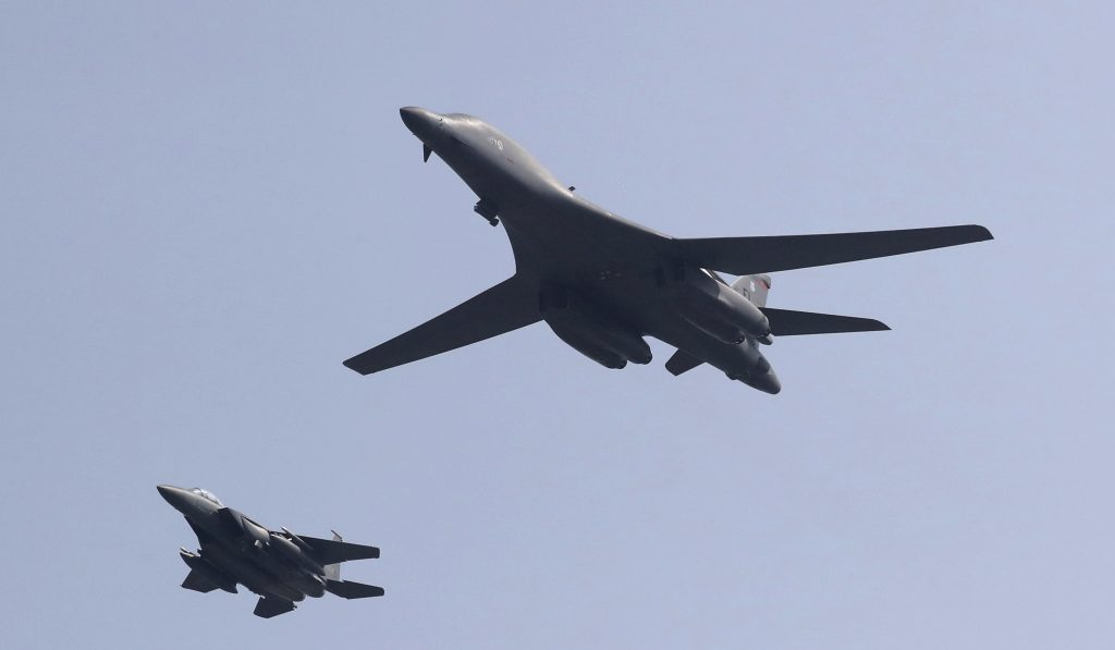 U.S. B-1B bomber, right, flies over Osan Air Base with South Korean Air Forces jet in Pyeongtaek, South Korea, Tuesday, Sept. 13, 2016. The United States has flown nuclear-capable supersonic bombers over ally South Korea in a show of force meant to cow North Korea after its fifth nuclear test and also to settle rattled nerves in the South. (AP Photo/Lee Jin-man)