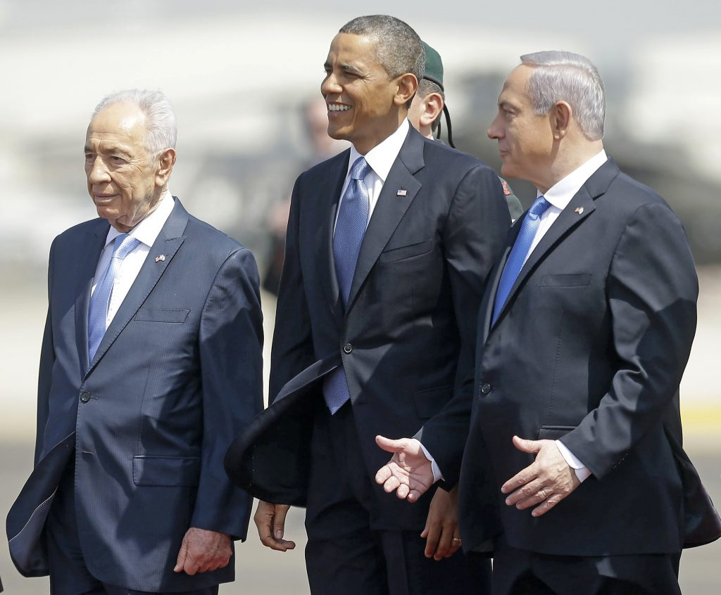 FILE - President Barack Obama is greeted by Israeli President Shimon Peres, left, and Israeli Prime Minister Benjamin Netanyahu upon his arrival ceremony at Ben Gurion International Airport in Tel Aviv, Israel. (AP Photo/Pablo Martinez Monsivais, File)