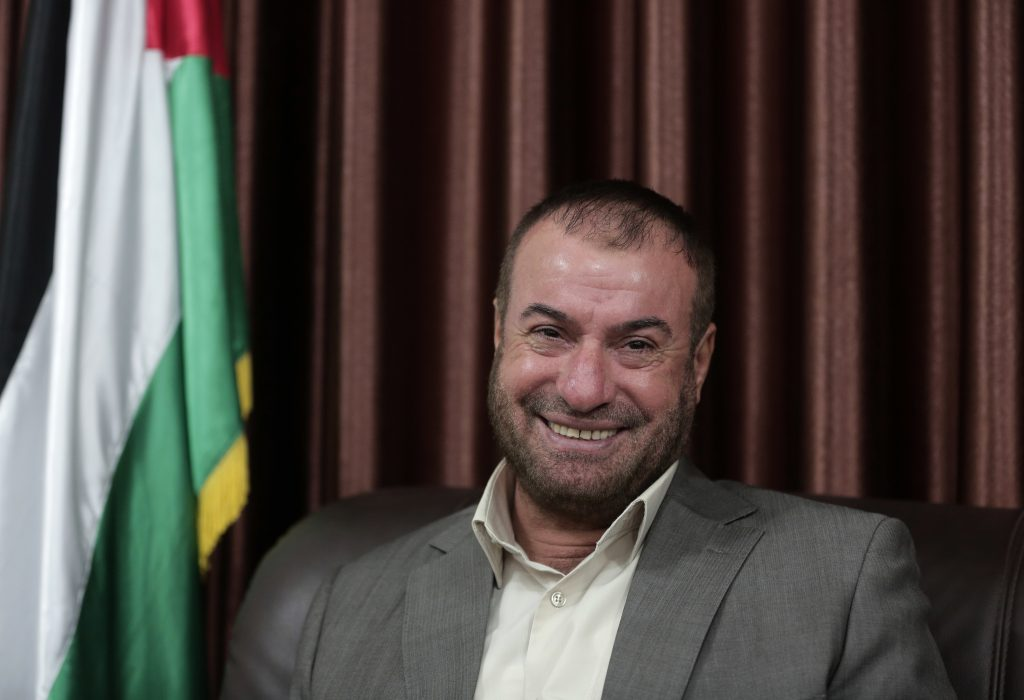 Palestinian senior Hamas official, Fathi Hammad, speaks to the Associated Press reporter during an interview in his house in town of Beit Lahiya, northern Gaza Strip, Saturday, Sept. 17, 2016. The State Department named Hammad, 55, to its list of Specially Designated Global Terrorists on Friday, saying he used his position as a minister to coordinate terrorist cells. In 2006, Hammad established Al-Aqsa satellite channel, which the state department said was Hamas' prime mouthpiece that sought recruiting children into future suicide bombers. (AP Photo/ Khalil Hamra)