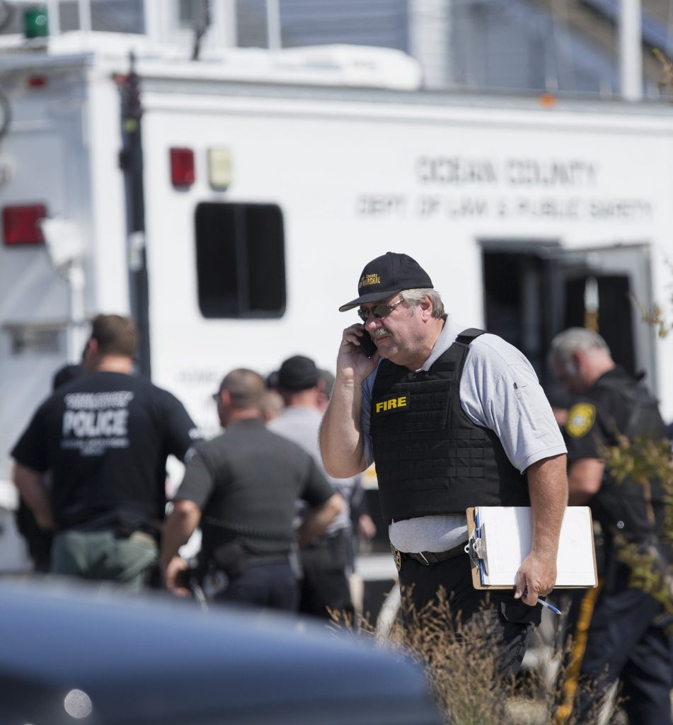 Police gather at a command center in Seaside Park, N.J., on Saturday, after the pipe-bomb blast. (Peter Ackerman/The Asbury Park Press via AP)