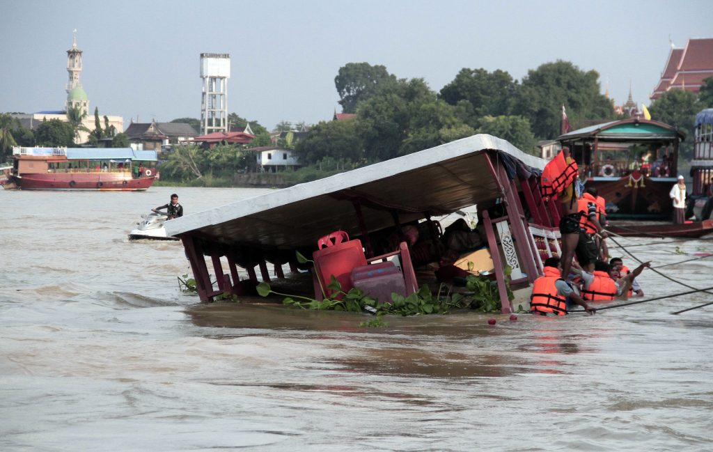 Thai rescue teams search for victims after a boat capsized at Chao Phraya River in Ayuthaya Province, Thailand, Sunday, Sept. 18, 2016. Thai news reports say at least 13 people were killed when a double-decker passenger boat carrying more than 100 people capsized in the Chao Phraya River north of Bangkok. Some people were still missing after the accident, which occurred when the boat was involved in a collision Sunday afternoon, but it was not immediately clear how many. (Dailynews via AP)
