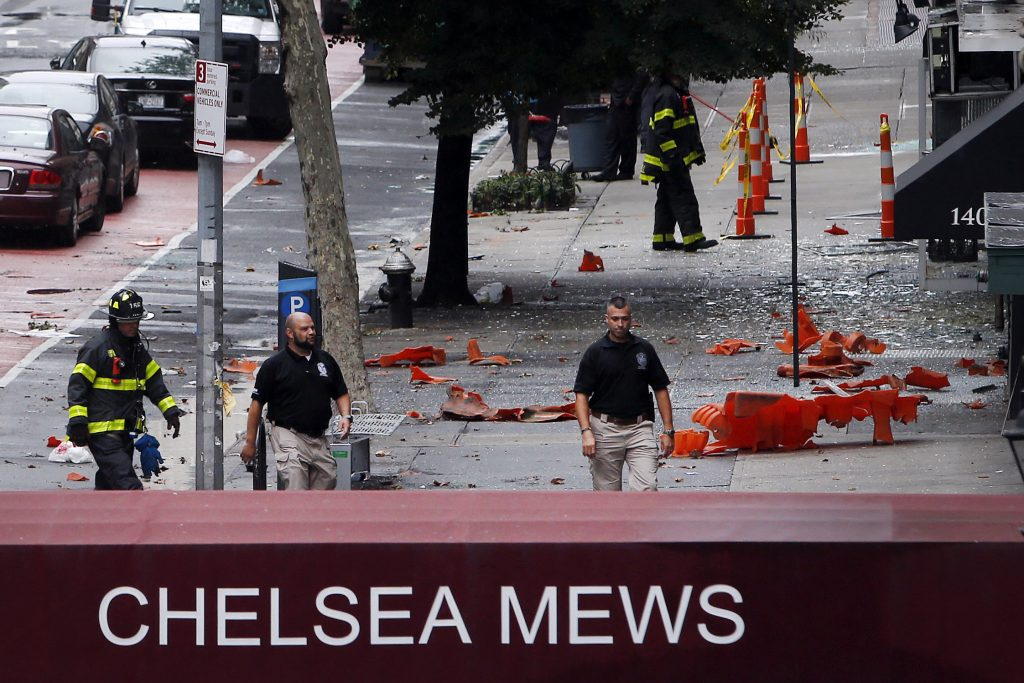 Emergency personnel work at the scene of the  explosion in Chelsea. (AP Photo/Jason DeCrow)