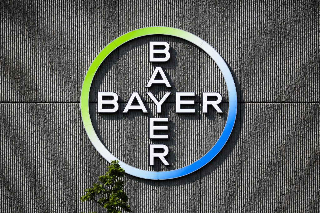 FILE - In this May 23, 2016, file photo the Bayer AG corporate logo is displayed on a building of the German drug and chemicals company in Berlin, Germany. The Senate is set to take a closer look at a proposed $66 billion merger of American seed and weed-killer company Monsanto and German medicine and farm chemical maker Bayer. (AP Photo/Markus Schreiber)