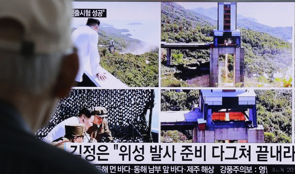 "A man watches a TV news showing images that North Korea's Rodong Sinmun newspaper reports of the ground test of a high-powered engine of a carrier rocket and North Korean leader Kim Jong Un at the country's Sohae Space Center, at Seoul Railway station in Seoul, South Korea, Tuesday, Sept. 20, 2016. North Korean leader Kim has overseen a ground test of a new rocket engine and ordered a satellite launch preparation, state media said Tuesday, an indication the country might soon conduct a prohibited long-range rocket launch. The letters read ""Kim Jong Un directed the ground test of a high-powered engine of a carrier rocket for a geo-stationary satellite."" (AP Photo/Ahn Young-joon)"