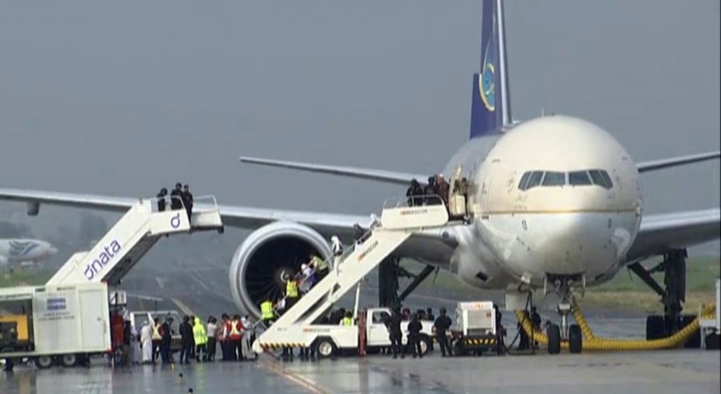 In this image made from video, people disembark a Saudi Arabian Airlines plane from Jeddah as it is parked at the airport in Manila, the Philippines, Tuesday, Sept. 20, 2016. (AP Photo)