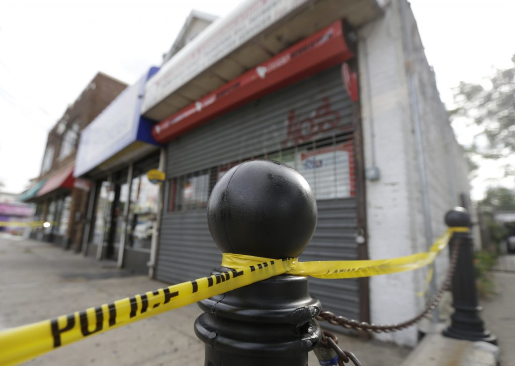 A police perimeter is seen outside the First American Fried Chicken restaurant, Tuesday, Sept. 20, 2016, in Elizabeth, N.J. The Elizabeth establishment and the apartment above are tied to Ahmad Khan Rahami, who was arrested as a suspect in the weekend bombings in New York and New Jersey. (AP Photo/Julio Cortez)