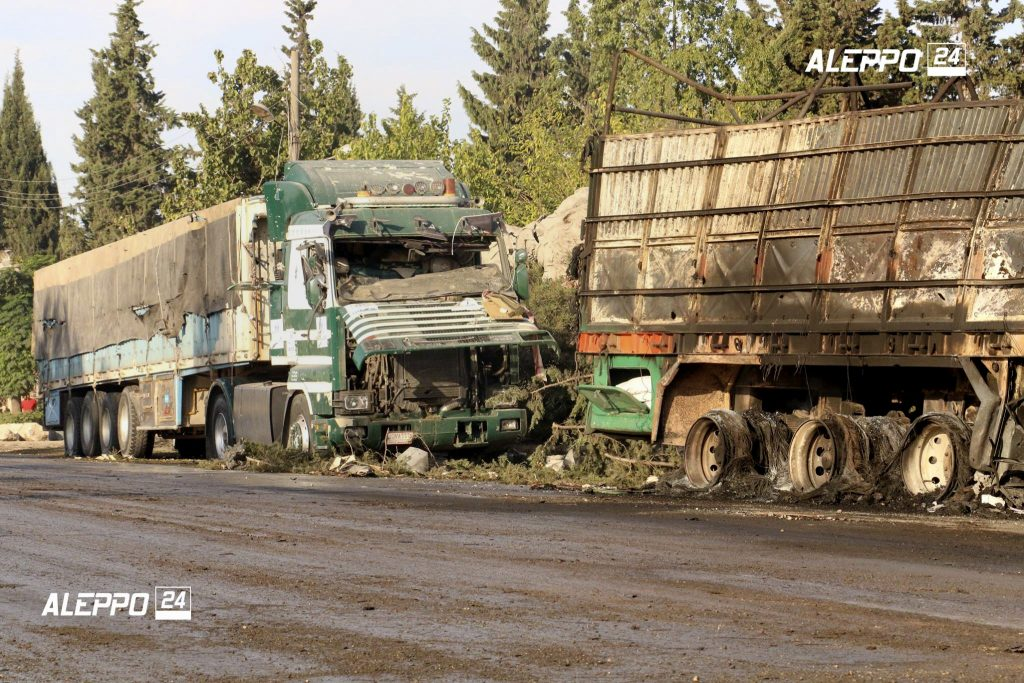 FILE - This Tuesday, Sept. 20, 2016, file image provided by the Syrian anti-government group Aleppo 24 news, shows damaged trucks carrying aid, in Aleppo, Syria. A U.N. humanitarian aid convoy in Syria was hit by airstrikes Monday as the Syrian military declared that a U.S.-Russian brokered cease-fire had failed, and U.N. officials reported many dead and seriously wounded. (Aleppo 24 news via AP)