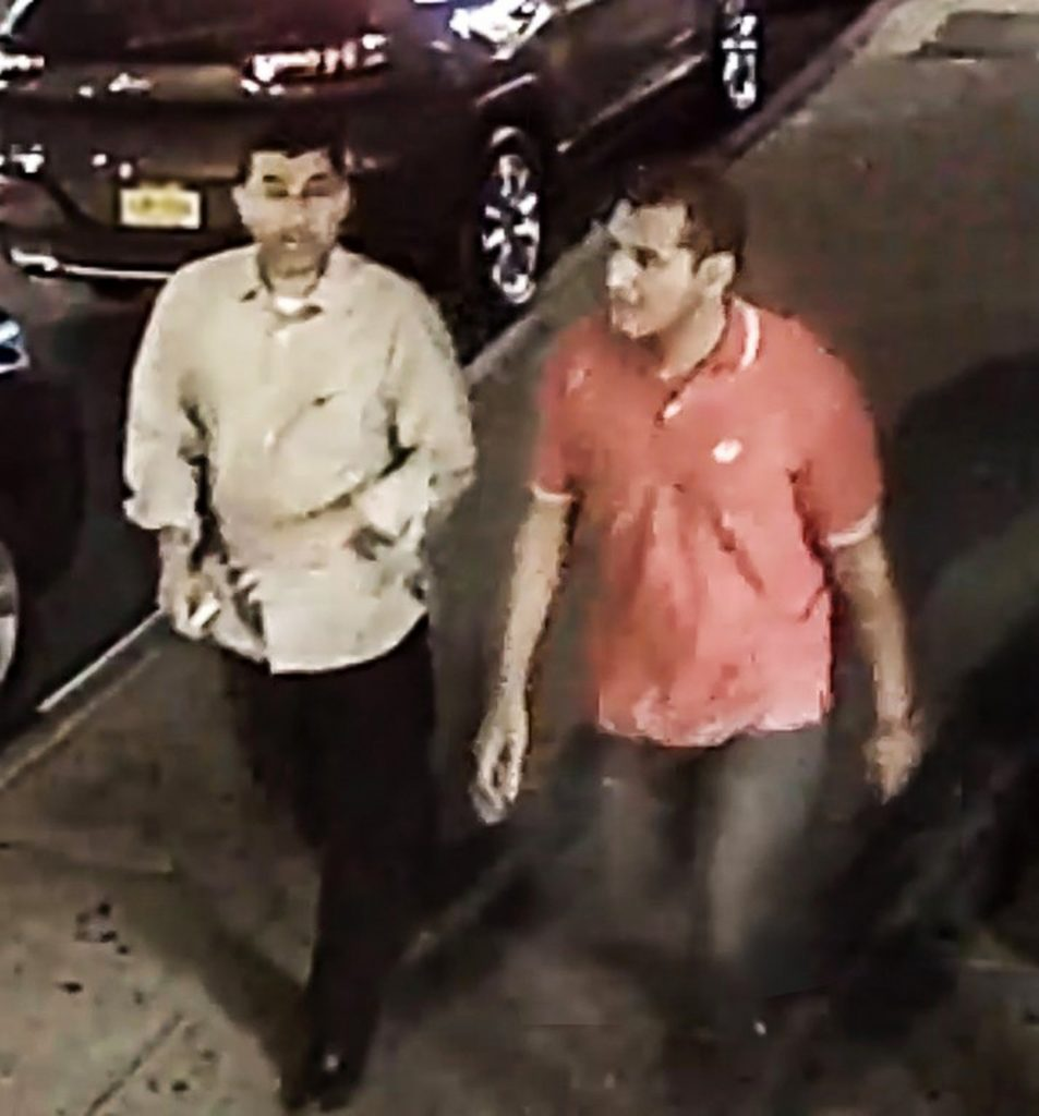 This video frame grab provided by the FBI shows two unidentified men walking in the Chelsea neighborhood of New York on Saturday, Sept. 17, 2016, around the time when a bomb exploded on a nearby street. Investigators said the men are being sought as witnesses in connection with the explosion and another explosive device that was found nearby. (FBI via AP)