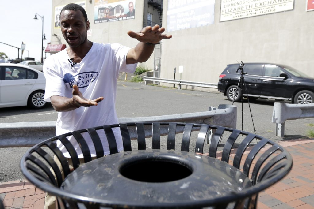 Lee Parker explains to reporters how he found a bomb near a trash can, Wednesday, Sept. 21, in Elizabeth, N.J. (AP Photo/Julio Cortez)