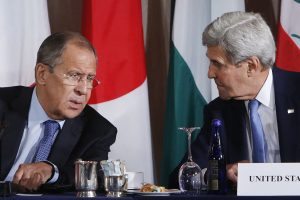 Russian Foreign Minister Sergey Lavrov (L) and U.S. Secretary of State John Kerry speak during a meeting of the International Syria Support Group, in New York on Thursday. (AP Photo/Jason DeCrow)