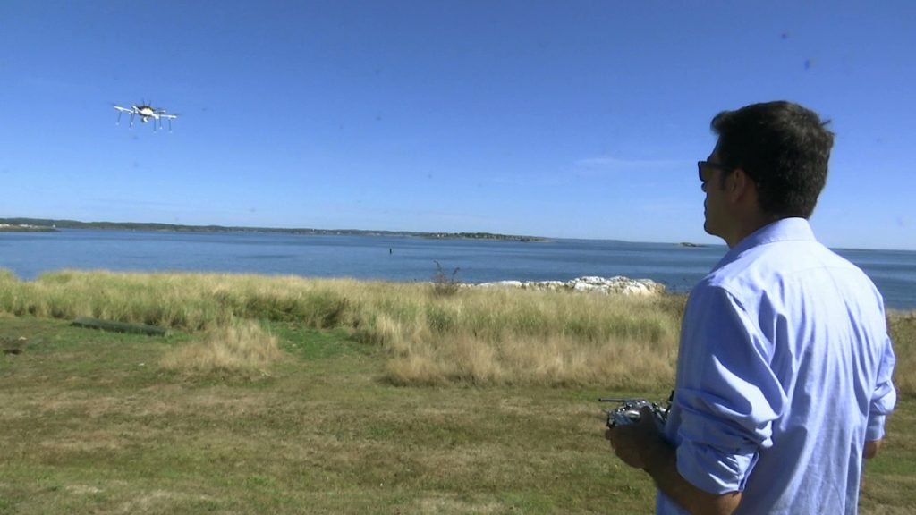 In this still image from video, aerospace engineer Felipe Bohorquez guides a test drone making a UPS delivery to Children's Island in Marblehead, Mass., on Thursday. (AP Photo/Rodrique Ngowi)