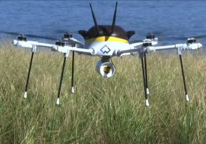 In this still image from video, a test drone making a UPS delivery lands on Children's Island in Marblehead, Mass., on Thursday. (AP Photo/Rodrique Ngowi)