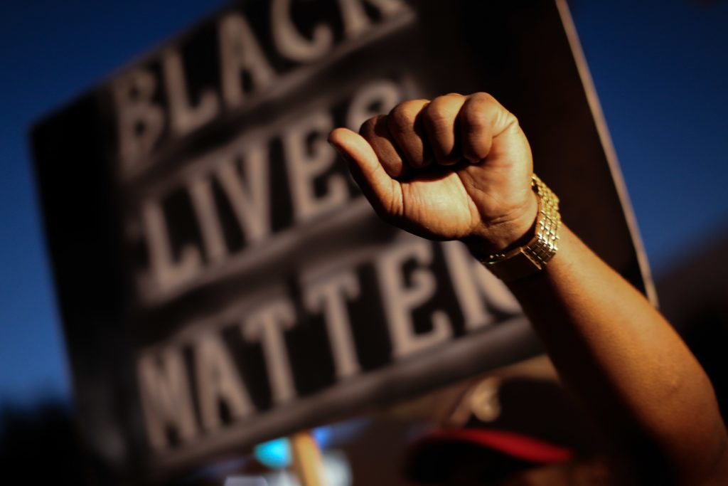CORRECTS NAME TO TERENCE CRUTCHER Demonstrators march in Atlanta on Friday, Sept. 23, 2016 in response to the police shooting deaths of Terence Crutcher in Tulsa, Okla. and Keith Lamont Scott in Charlotte, N.C. (AP Photo/Branden Camp)