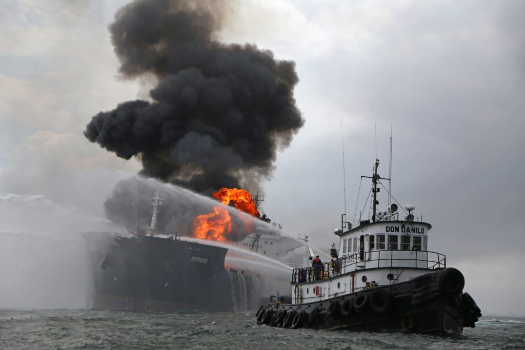 A firefighting boat works to extinguish a fire aboard the tanker Burgos about seven nautical miles off the coast of the port city of Boca del Rio, Mexico, Saturday, Sept. 24. (AP Photo/Ilse Huesca)