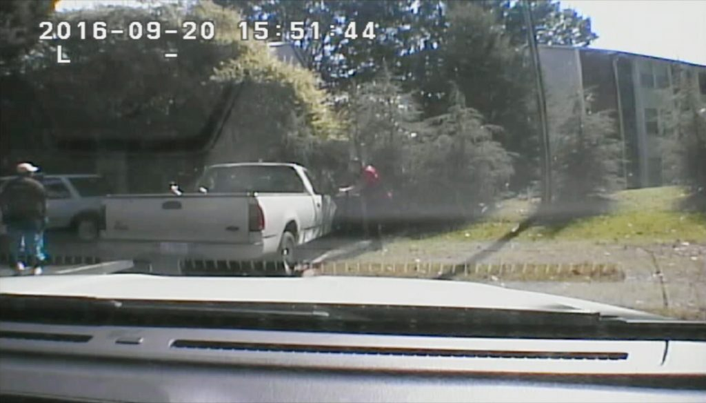 This image made from video provided by the Charlotte-Mecklenburg Police Department on Saturday, Sept. 24, shows Keith Scott, left, moments before he was fatally shot by police in Charlotte, N.C., on Sept. 20. (Charlotte-Mecklenburg Police Department via AP)
