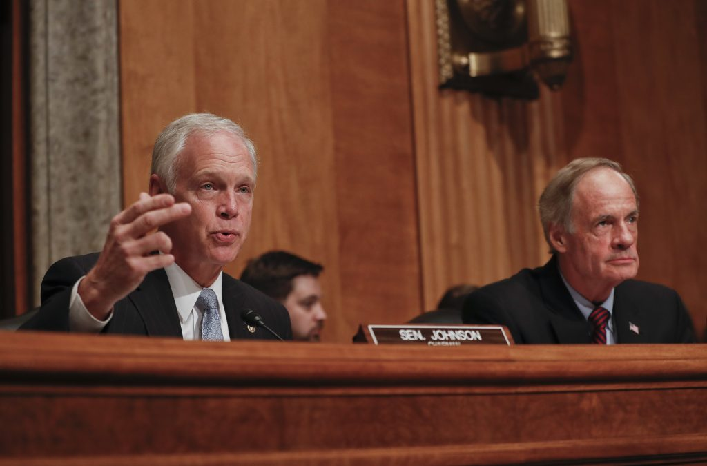 Senate Homeland Security and Governmental Affairs Committee Chairman Sen. Ron Johnson, R-Wis., left, accompanied by the committee's ranking member Sen. Tom Carper, D-Del., speaks during the committee's hearing on on terror threats on Tuesday. (AP Photo/Pablo Martinez Monsivais)