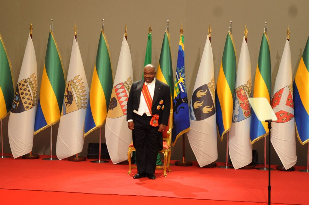 Gabon's President Ali Bongo Ondimba stands on stage as he is sworn in for a second term in Libreville. Gabon, on Tuesday. (AP Photo/Jeremi Mba)