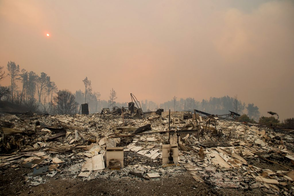 Rubble lines a residence leveled by the Loma fire along Loma Chiquita Road near Morgan Hill, Calif., on Tuesday. (AP Photo/Noah Berger)