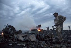On July 17, 2014, people walk among the debris, at the crash site  near the village of Grabovo, Ukraine. (AP Photo/Dmitry Lovetsky, File)