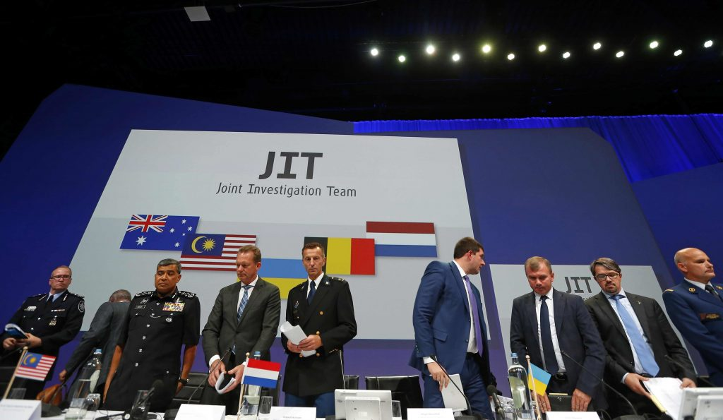 Members of the Joint Investigation Team (JIT)  after a press conference on the preliminary results of the investigation into the shooting-down of Malaysia Airlines jetliner flight MH17 in Nieuwegein, Netherlands, on Wednesday. (AP Photo/Peter Dejong)