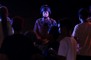 A police officer blocks the on-ramp to a freeway during a protest Wednesday in El Cajon, Calif. (AP Photo/Gregory Bull)
