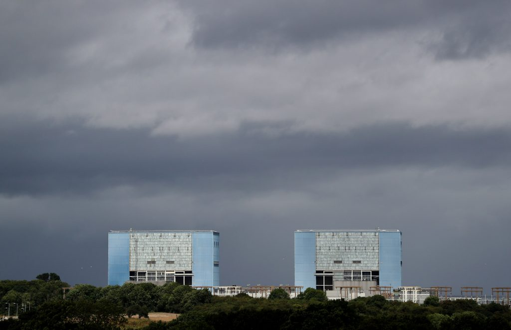 "FILE - This is a July 28, 2016 file photo of of Hinkley Point A Magnox nuclear power station in Hinkley Point Somerset, southwest England . The British government Thursday Sept. 15, 2016 has approved construction of the country's first new nuclear power plant in decades, to be built with Chinese investment. The government says in a statement that it has ""decided to proceed"" with the Hinkley Point plant. Prime Minister Theresa May unexpectedly stalled the deal after she took office in July. (Andrew Matthews/PA, File)"