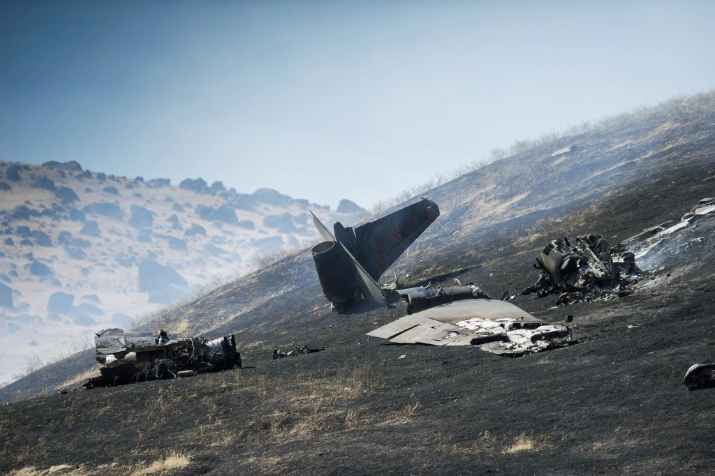 An aircraft assigned to the 1st Reconnaissance squadron at Beale Air Force Base and on a training mission went down on the lower slopes of the Sutter Buttes on Tuesday, Sept. 20, 2016 in Sutter County, Calif. (Hector Amezcua/The Sacramento Bee via AP)