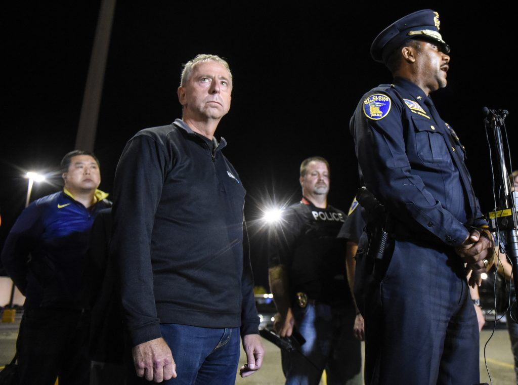St. Cloud mayor Dave Kleis, left, and Police Chief Blair Anderson hold a press conference early Sunday morning, Sept, 18, 2016, from a parking lot near Crossroads Center in St. Cloud, Minn. A man in a private security uniform stabbed nine people at a Minnesota shopping mall Saturday, reportedly asking one victim if they were Muslim before an off-duty police officer shot and killed him in an attack the Islamic State group claimed as its own. (Dave Schwarz/St. Cloud Times via AP)