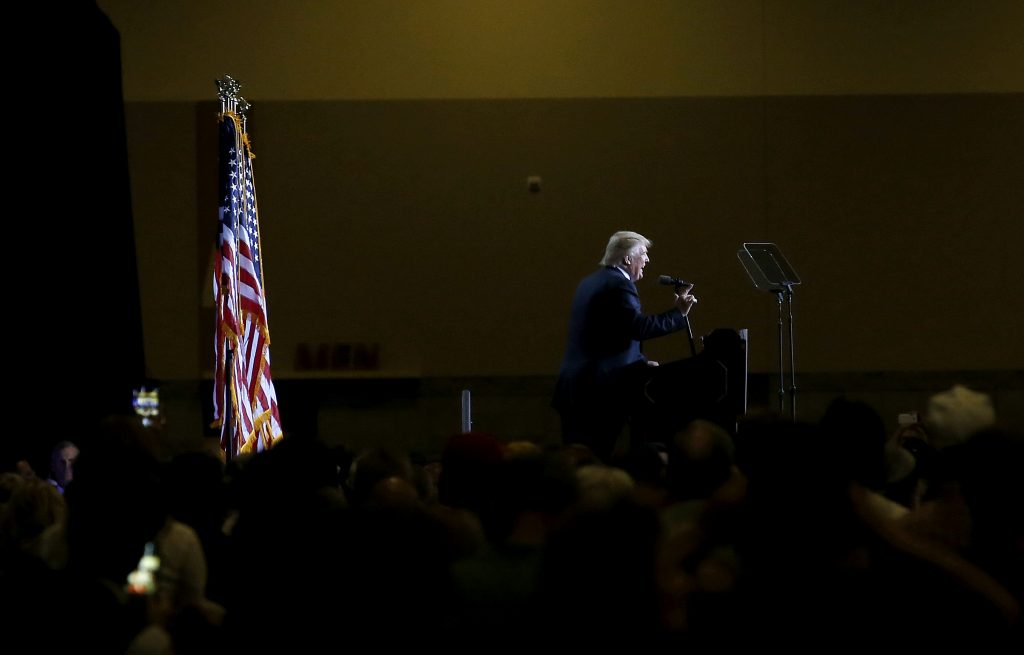 Republican presidential candidate Donald Trump delivers an immigration policy speech during a campaign rally at the Phoenix Convention Center, Wednesday, Aug. 31, 2016, in Phoenix. (AP Photo/Ross D. Franklin)