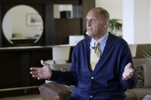 Alan Amron speaking to a reporter in West Palm Beach, Fla., in March, about his lawsuit against 3M. (AP Photo/Alan Diaz)