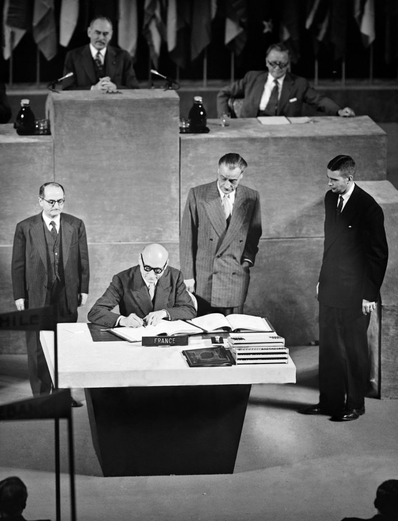 France's Robert Schuman signs Japanese peace treaty at San Francisco, Calif., on Sept. 8, 1951. Behind him Paul Naggiar, (L), Henri Bonnet, and John W. Foley Jr.  (AP Photo)