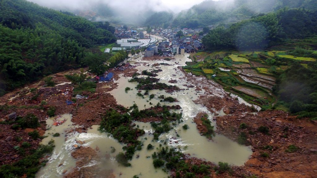 The site of a landslide caused by heavy rains brought by Typhoon Megi, in Sucun Village, Lishui, Zhejiang province, China, September 29, 2016. China Daily/via REUTERS ATTENTION EDITORS - THIS IMAGE WAS PROVIDED BY A THIRD PARTY. EDITORIAL USE ONLY. CHINA OUT. NO COMMERCIAL OR EDITORIAL SALES IN CHINA.