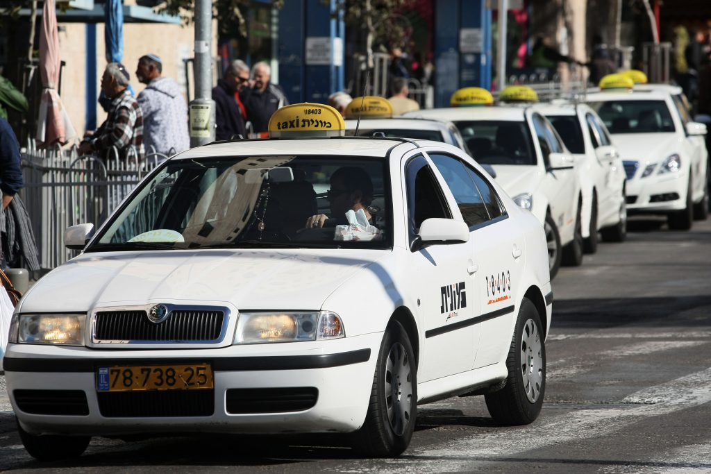 Taxis waiting for passengers near the Yerushalayim Central Bus Station. (Kobi Gideon/ Flash90)