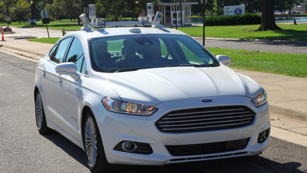 An experimental Ford Fusion autonomous car, lidar sensors on the roof, drives itself in Dearborn, Mich., on Sept. 12, 2016. (Russ Mitchell/Los Angeles Times/TNS)