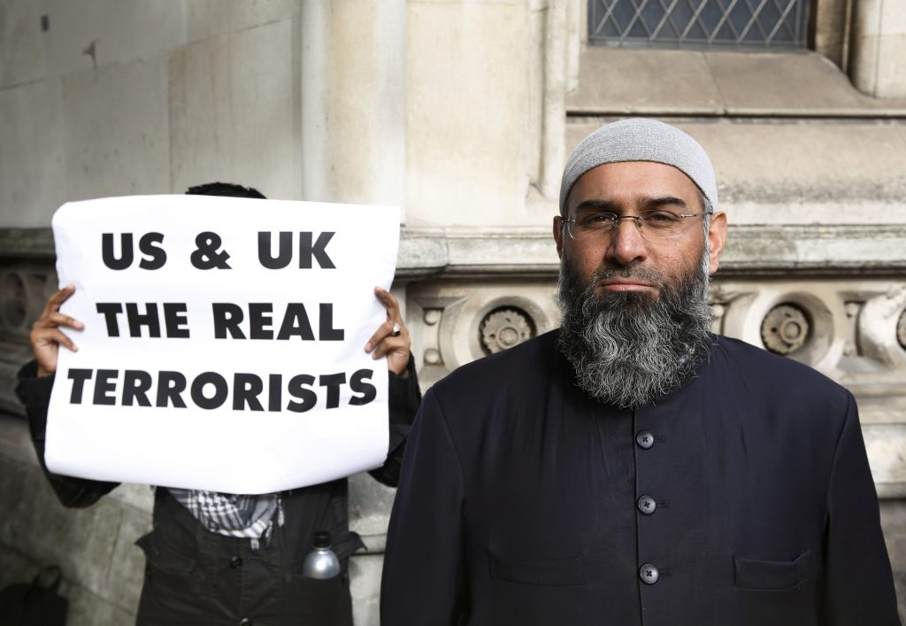 Demonstrator Anjem Choudary, protests in support of Islamist cleric Abu Hamza al-Masri, who is appealing against his extradition to the U.S., outside the High Court in London October 5, 2012. REUTERS/Luke MacGregor/File Photo