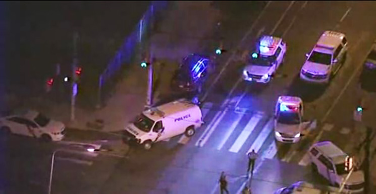 A wild chase and shootout through the streets of Philadelphia left two police officers and three civilians wounded and a woman