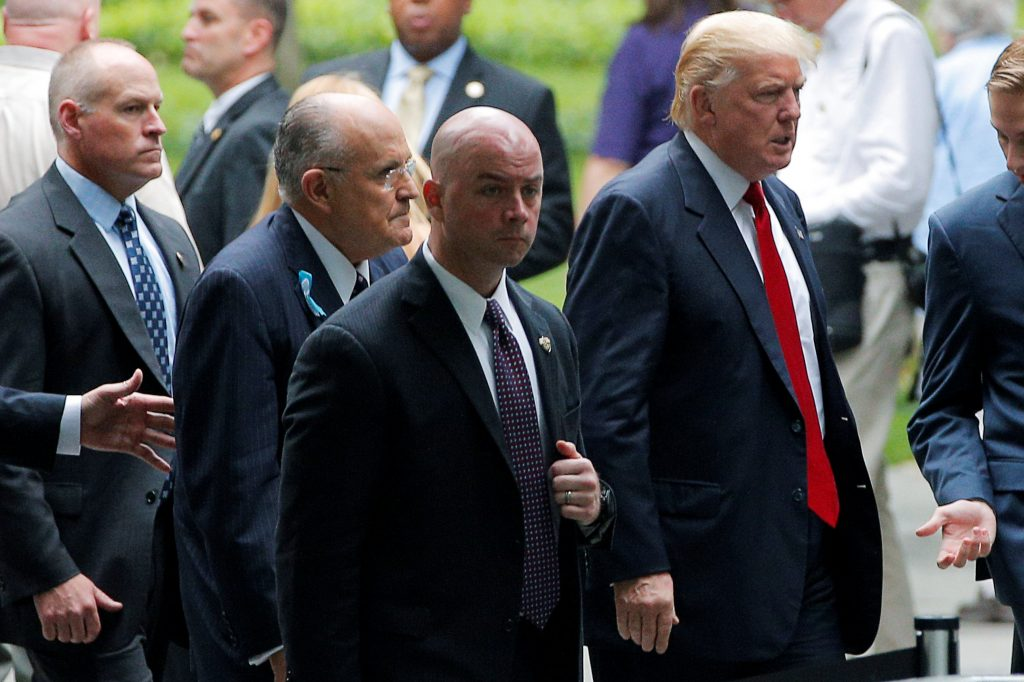 U.S. Republican presidential candidate Donald Trump (R) and former New York City Mayor Rudy Giuliani (2nd L) arrive for ceremonies to mark the 15th anniversary of the September 11 attacks at the National 9/11 Memorial in New York, New York, United States September 11, 2016. REUTERS/Brian Snyder